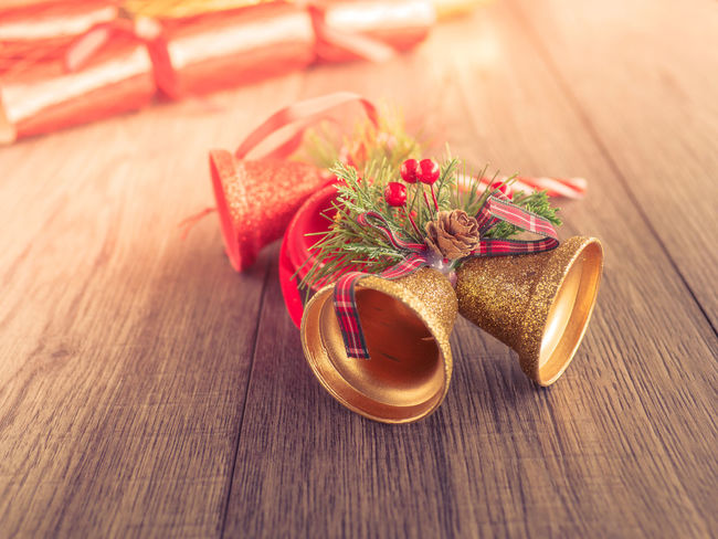 Christmas decoration stuff on table Christmas Christmas Bell Copy Space Background Christmas Decoration Christmastime Close-up Day Flower Food Food And Drink Freshness High Angle View Indoors  No People Red Table Wood - Material