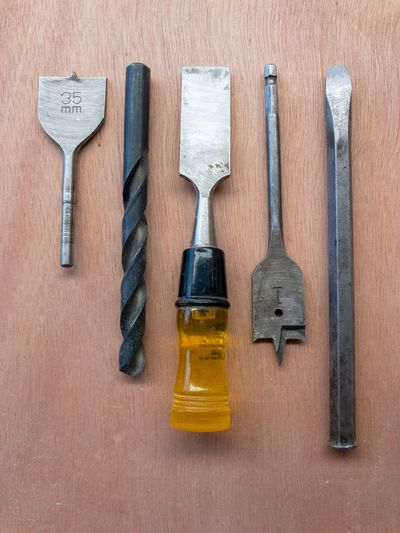 Directly above shot of work tools on wooden table