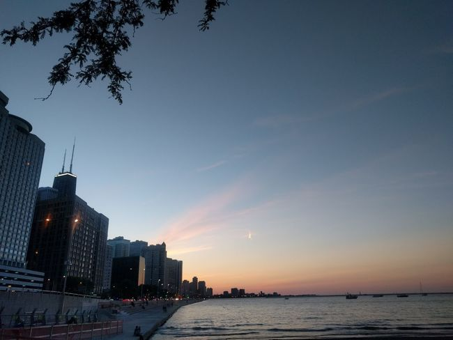 Chicago city coastline Sky Building Exterior Architecture Built Structure Water Sunset Building Nature City Office Building Exterior Skyscraper No People Dusk Urban Skyline Sea Waterfront Silhouette Tree Outdoors