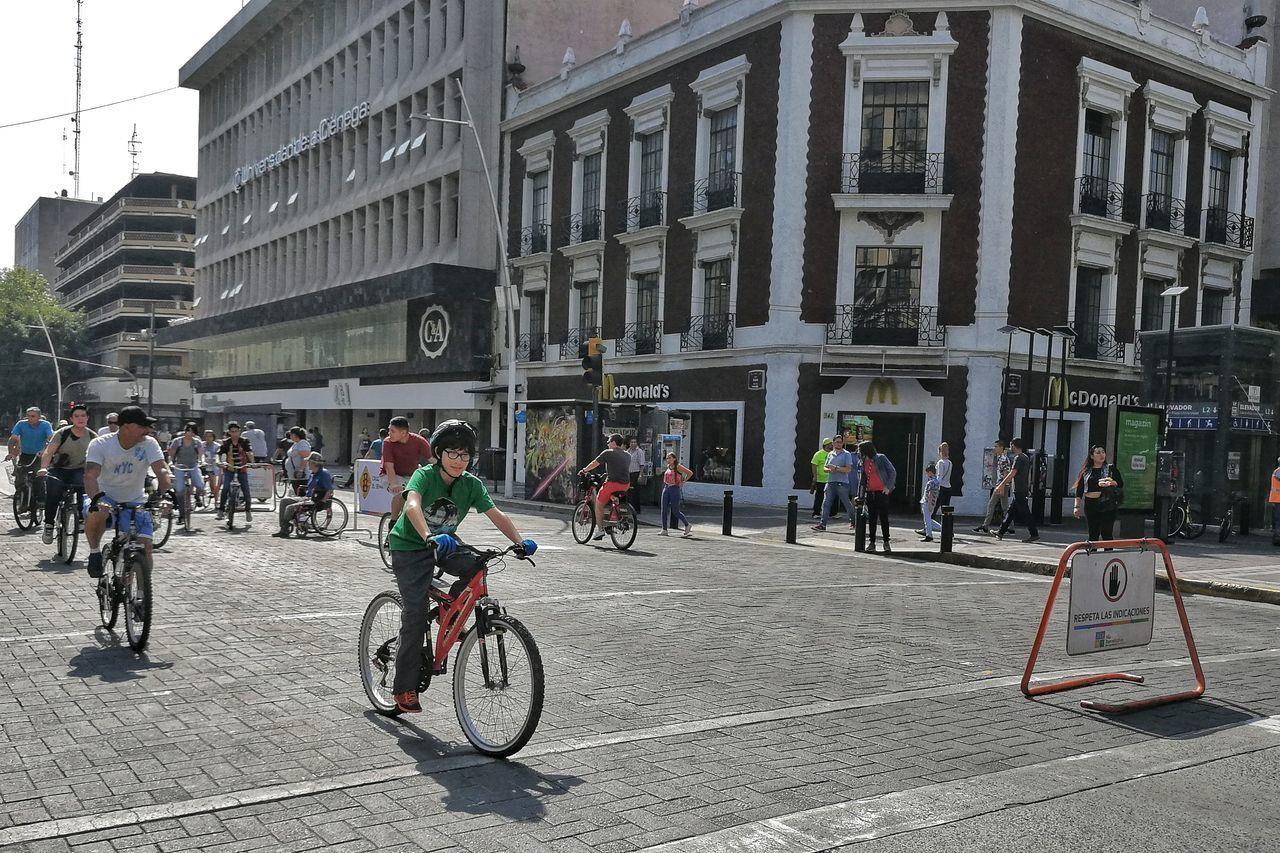 PEOPLE ON STREET AGAINST BUILDINGS
