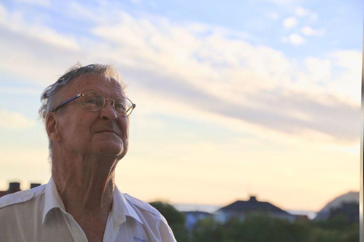 Senior man against sky during sunset