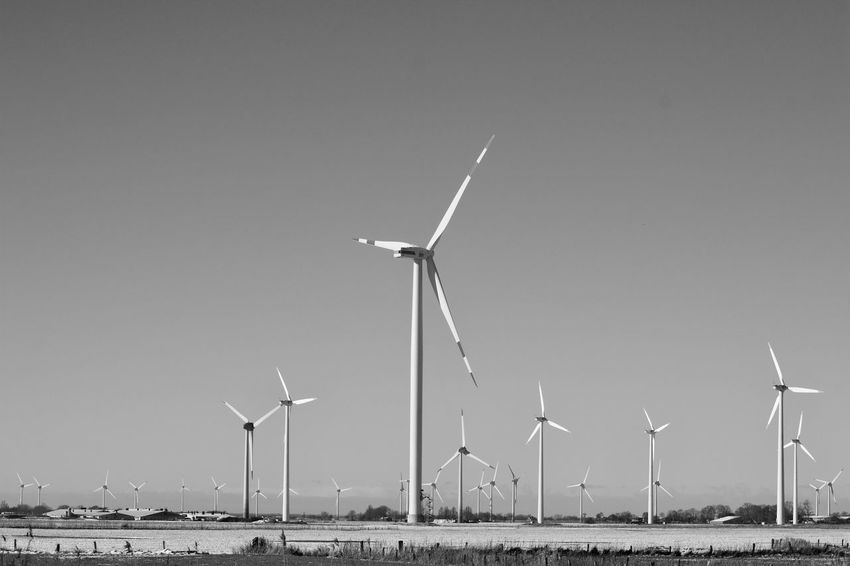 Alternative Energy Clear Sky Copy Space Day Environment Environmental Conservation Field Fuel And Power Generation Land Landscape Nature No People Outdoors Power Supply Renewable Energy Rural Scene Sky Sustainable Resources Technology Turbine Wind Power Wind Turbine