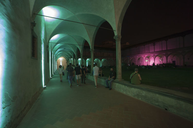 Florence, Santa Croce church and cloister. Adult Arcade Arch Architectural Column Architecture Building Built Structure Colonnade Corridor Crowd Group Of People Illuminated Indoors  Large Group Of People Leisure Activity Lifestyles Men Night Real People Women
