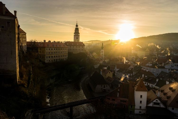 Silhouette of cesky krumlov castle and townscape during sunset