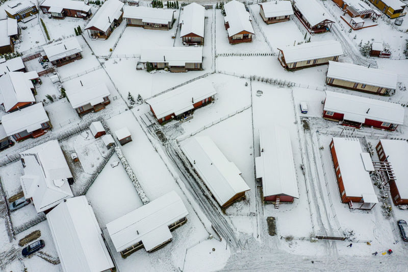 High angle view of snow covered roof and buildings in city