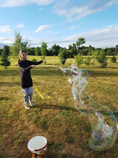 Soap Bubbles Big Soap Bubble Women Playing With Soap Bubbles Standing Full Length Fun Sky