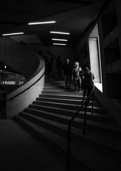 Illuminated view. Indoors  Real People People Women Men Architecture Modern Black & White Light In The Darkness Streetphoto_bw Documentary Photography Sunlight Incidental People Architecture London Built Structure Stairways Spiral Staircase Tate Modern Gallery