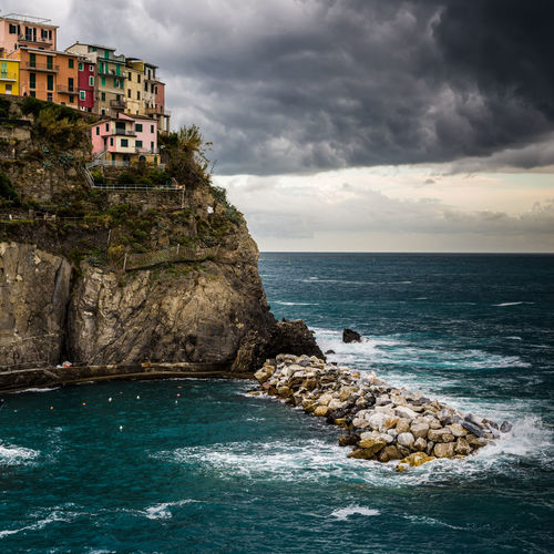 Dramatic storm clouds rolling in over manarola, cinqeterre, italy.