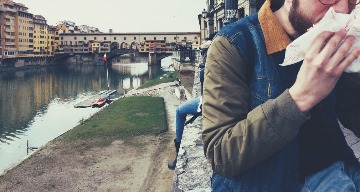 Ponte Vecchio Florence Lungarno Real People Built Structure Architecture Connection Building Exterior Day Bridge - Man Made Structure Outdoors Men Sitting Water Two People Lifestyles Togetherness City Nature Close-up Sky Italy Travel Destinations