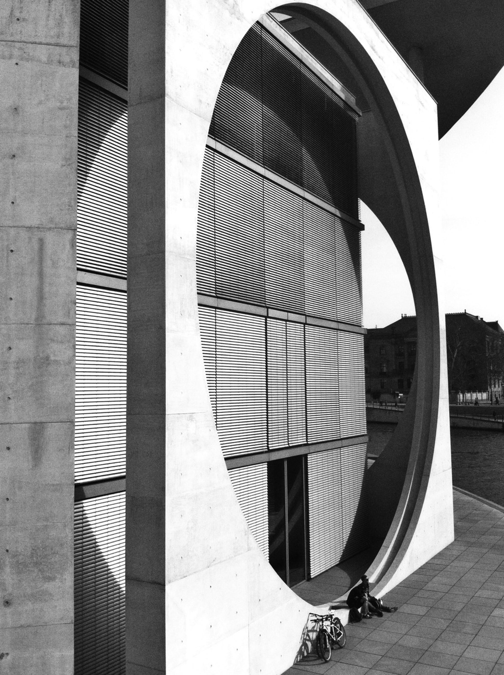 architecture, built structure, building exterior, city, modern, pattern, reflection, day, building, sky, no people, outdoors, arch, sunlight, railing, close-up, circle, window, shape, protection