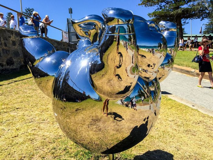 Sculpture: Reflecting the Beach Modern Art Arts Festivals ArtWork Three-dimensional Abstract Art People Figure Arts And Entertainment Interactive  March 12,2016 Sculptures By The Sea Sculptures Western Australia Tourist Attraction  Cottesloe Beach Artistic Expression Tourists Silver  Mirrored Reflective Surface Culture Metallic Metal Round Belly Belly