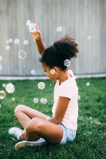 Fun Kids Bubble Bubble Wand Childhood Day Grass Happiness Joy Leisure Activity Lifestyles One One Person Outdoor Outdoors Park People Real People Smiling Young Adult Young Women