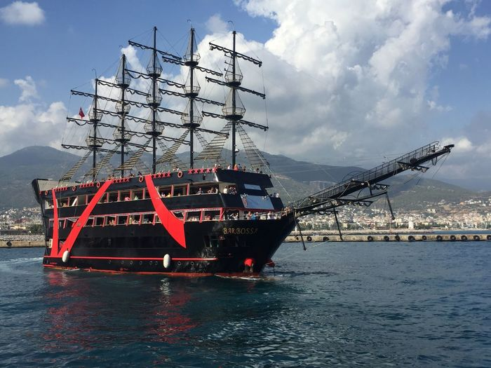 Traditional ship on sea against sky