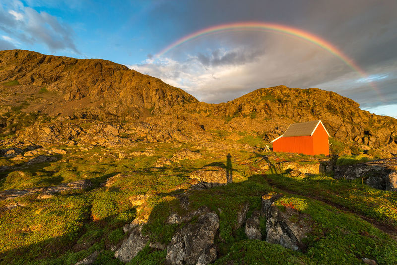 Architecture Beauty In Nature Building Exterior Cloud - Sky Day Double Rainbow Dramatic Sky Hiking House Lyngen Alps Midnight Sun Mountain Nature No People Northern Norway Norway Outdoors Rain Rainbow Red Scenics Shadow Sky Tranquility Weather Lost In The Landscape