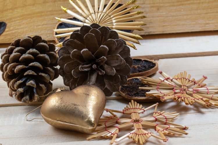 Close-up of pine cone on table