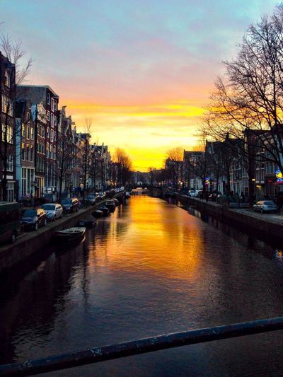 I'd standing on canal.... Soaking Up The Sun Enjoying The Sunset Traveling Amsterdam