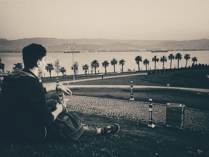 Filters Gray Color EyeEm Selects Sitting People Sky Beach Water Sea Outdoors One Person One Man Only
