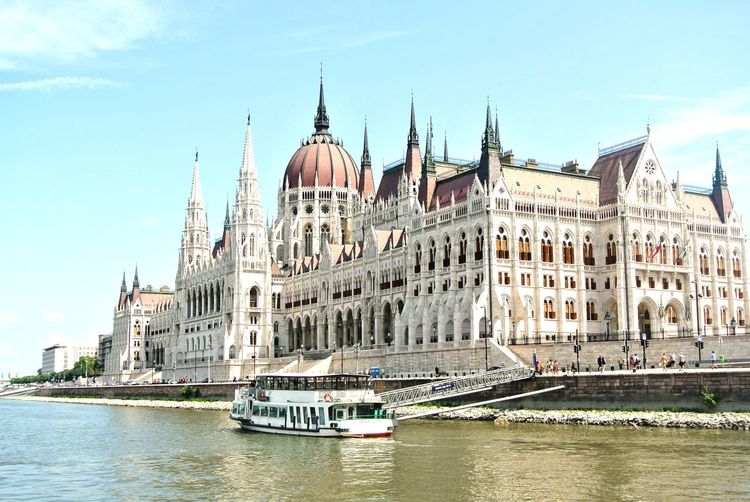 Ferry Sailing On River By Hungarian Parliament Building