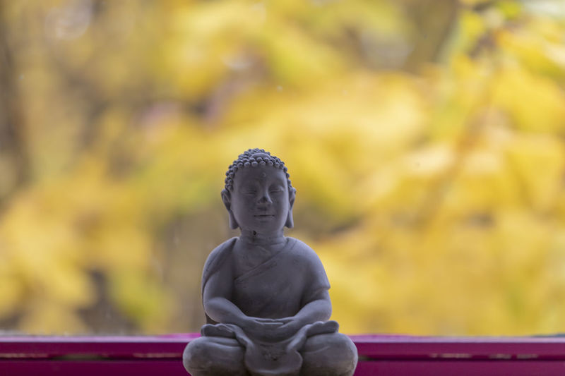 Statue of buddha against blurred background