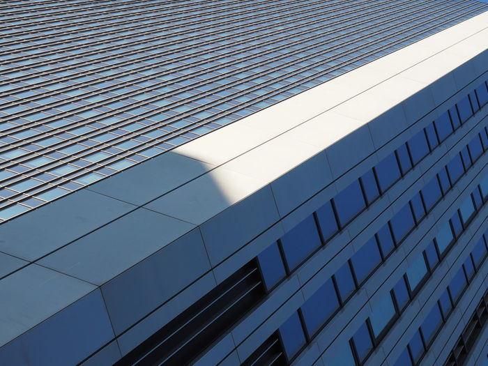 Architecture Blue Building Exterior Built Structure City Corporate Business Day Financial District  Low Angle View Modern No People Outdoors Pattern Real Estate Repeating Patterns Repetition