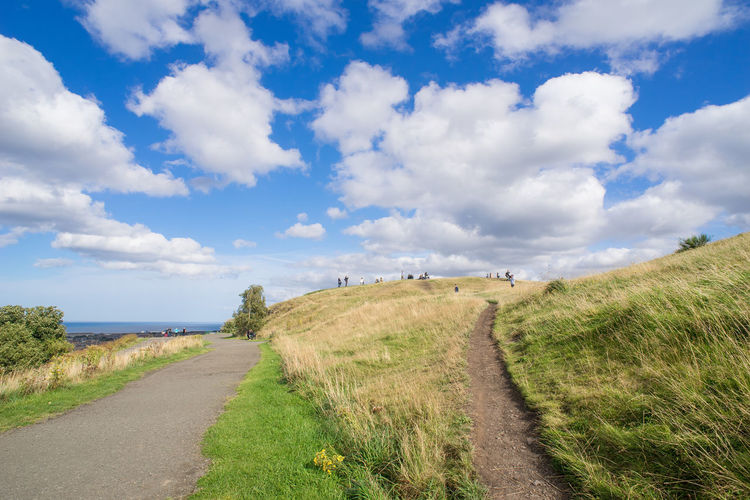 Many visitors enjoying bright but gentle sunlight and Autumn breeze at top of Calton Hill, Edinburgh, UK. Autumn Blue Sky Calton Hill Edinburgh Landscape Meadow Nature Outdoors Path People Season  Sunny Track Trails Travel Destinations Travel Photography Traveling Visitors White Clouds Yellow Grass