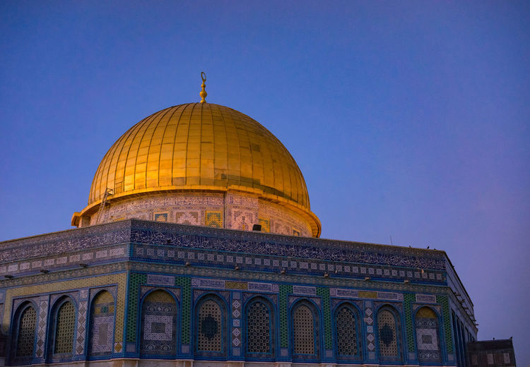 Low angle view of majidil aqsa mosque against blue sky