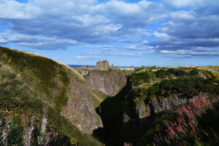 Aberdeenshire Dunnottar Castle Scotland Beauty In Nature Cloud - Sky Day Environment Land Landscape Mountain Nature Non-urban Scene Outdoors Plant Rock Rock - Object Rock Formation Ruined Castle Scenics - Nature Sky Solid Tranquil Scene Tranquility Tree