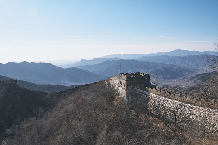 View of great wall of china against sky with mountains in the background
