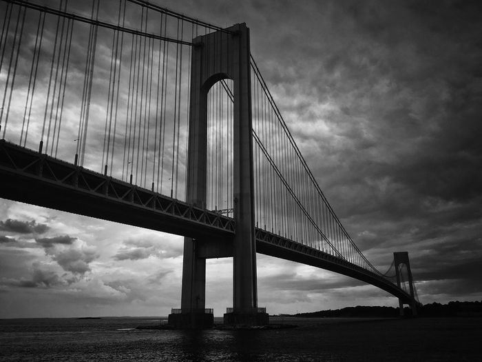 EyeEm Selects Bridge - Man Made Structure Connection Engineering Architecture Built Structure Suspension Bridge Transportation Sky Travel Destinations Cloud - Sky Bridge Travel River Low Angle View Outdoors Day No People Water Nature Building Exterior Verrazano-Narrows Bridge