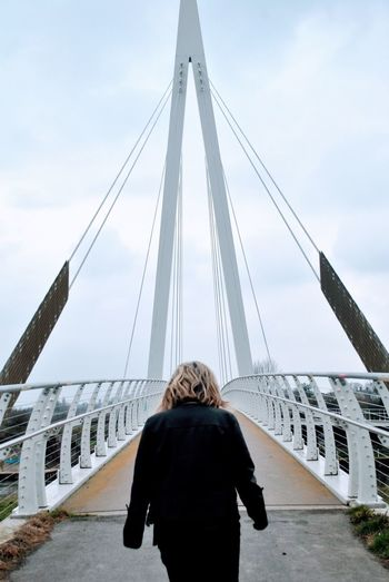 Bridge walks Adventure Suspension Bridge Hereford Real People Rear View Built Structure Sky One Person Architecture Lifestyles Women Leisure Activity Cloud - Sky Day Nature Connection Bridge Bridge - Man Made Structure Engineering Standing Warm Clothing Winter Adult The Photojournalist - 2018 EyeEm Awards The Street Photographer - 2018 EyeEm Awards