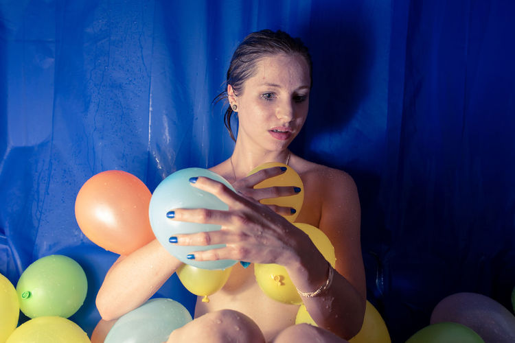 Shirtless Woman With Colorful Balloons At Home