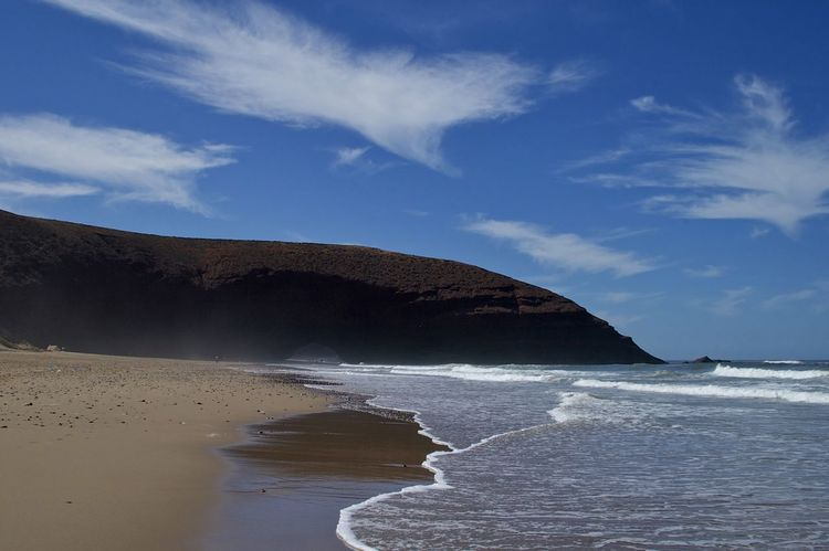 The beach in Mirleft, Morocco. Morocco MoroccoTrip Natural Arch Arch Beach Beauty In Nature Cloud - Sky Mirleft Nature No People Sand Scenics Sea Stone Arch Tranquil Scene Tranquility Water Wave
