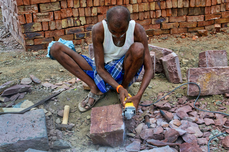 Shaping Stones At Work Brick Wall Building Cutting House Building Mason Men One Man Only One Person Outdoors Real People Stone Cutting Stone Grinding Wheel Stones Village Work Worker