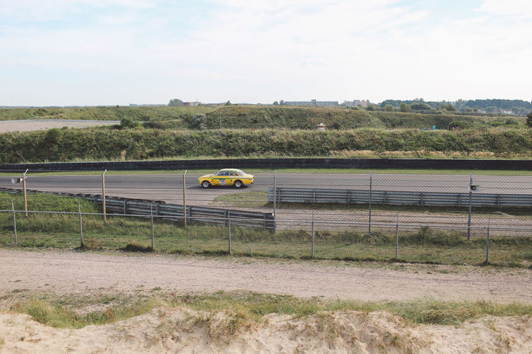 Car moving on race track
