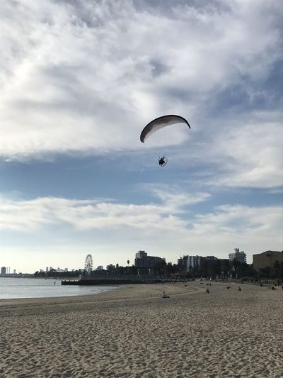 A paraplane over St KIlda Beach. Australia Adventure Extreme Sports Sky Cloud - Sky Parachute Land Sport Nature Flying Unrecognizable Person Leisure Activity Beauty In Nature Sand Mid-air Day Beach Scenics - Nature Real People One Person Outdoors Freedom Paraplane Powered Parachute Motorised Parachute St Kilda Beach Australia
