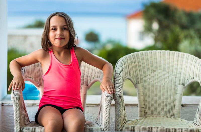Portrait of a girl sitting on seat