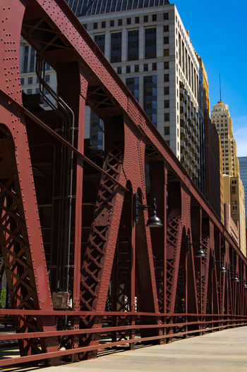 Low angle view of bridge in city