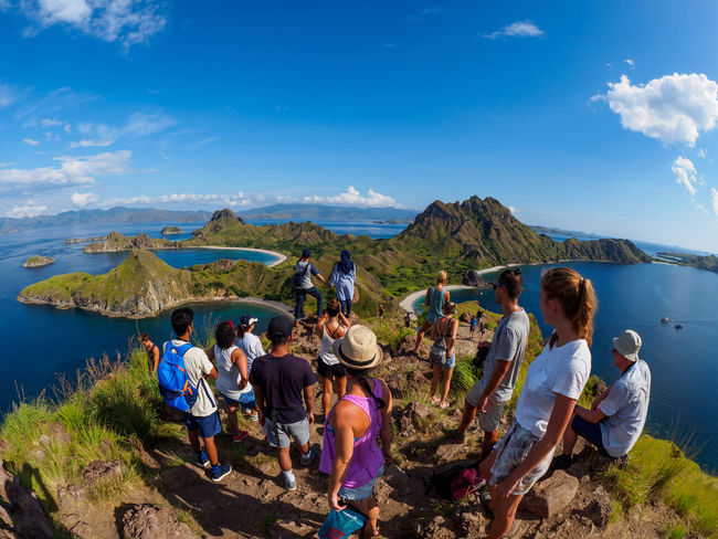 Padar Island, Indonesia Adult Beauty In Nature Cloud - Sky Crowd Day Group Of People Large Group Of People Leisure Activity Lifestyles Looking At View Men Mountain Mountain Range Nature Outdoors Padar Island Real People Scenics - Nature Sky Togetherness Water Women