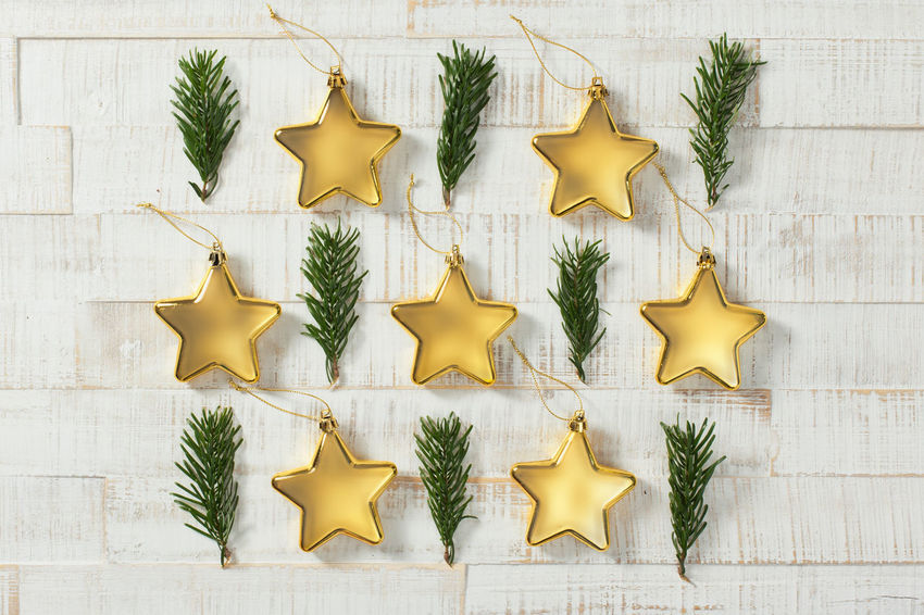 Golden Christmas stars and fir branches in a pattern on white wood Christmas Ornament Decoration Gold Colored Indoors  No People Still Life Yellow