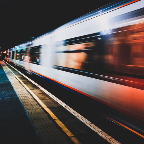 Blurred motion of train at railroad station at night