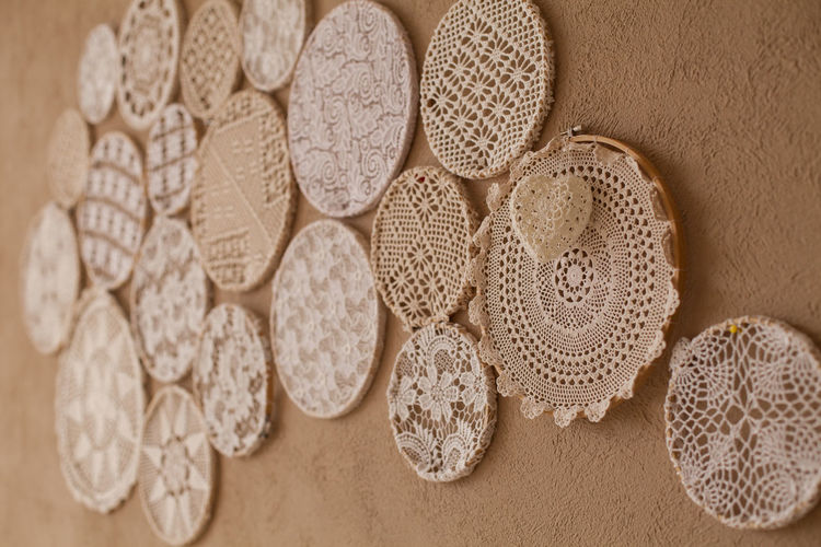Close Up Of Doilies On Wall