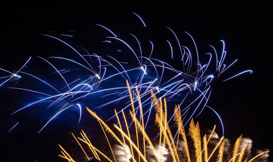 Illuminated Night Long Exposure Motion Firework Celebration Firework Display Black Background Sky Blue Yellow