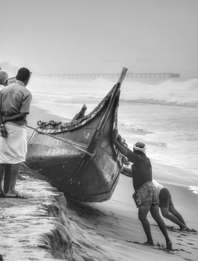 Live For The Story Sea Beach Fisherman Adult People Fishing Outdoors Working Water Only Men Occupation Nature Horizon Over Water Fishing Net Beauty In Nature Surprise Nature The Street Photographer - 2017 EyeEm Awards