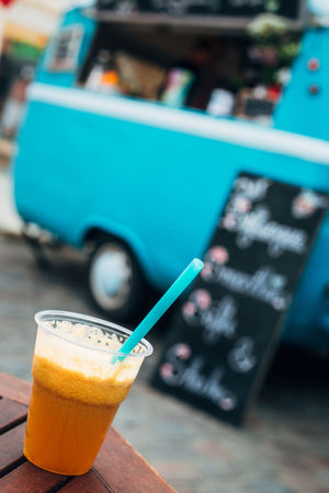 Juice truck Juice Close-up Cup Day Drink Drinking Cup Drinking Straw Focus On Foreground Food And Drink Food Truck Freshness Healthy Indoors  No People Refreshment Smoothie Table Technology