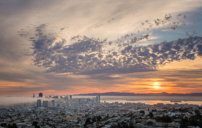 Morning Fog Retreats Architecture Cityscapes Cloud Cloud - Sky Cloudy Dramatic Sky Fog Ocean Orange Color Outdoors Sky Storm Cloud Sunrise Sunset