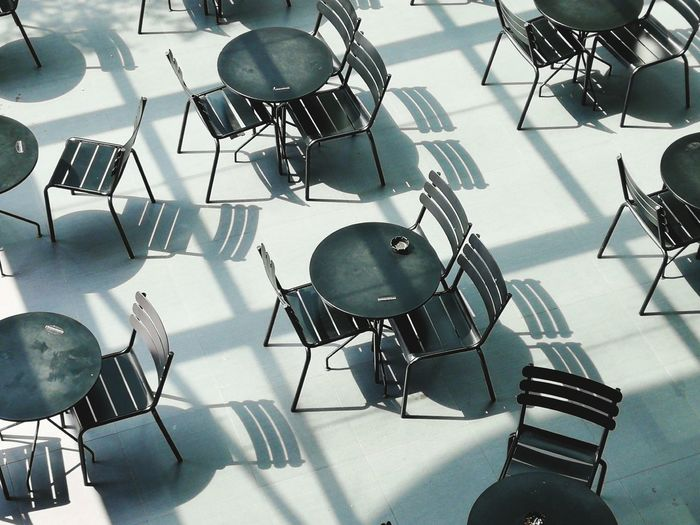 High angle view of empty chairs and tables