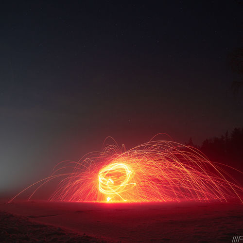 Night Long Exposure Motion Illuminated Wire Wool Sky Glowing Blurred Motion Land Nature Spinning Light Trail Speed No People Field Outdoors Light Painting Copy Space Sparks Scenics - Nature Light