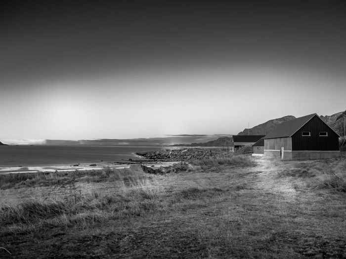Grotfjord Architecture Beach Beauty In Nature Black And White Blackandwhite Building Exterior Built Structure Clear Sky Day Field Grass Horizon Over Water House Landscape Nature No People Nordic Beach Outdoors Scenics Sea Sky Tranquil Scene Tranquility Water