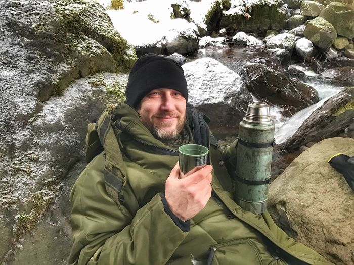 Live For The Story Portrait Looking At Camera Beard Rock - Object Smiling Cold Temperature Green Color One Person Outdoors Winter Real People Lifestyles Happiness Men Nature Day Headwear One Man Only Water Adult Camping