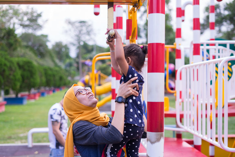 Happy mother and daughter playing at playground.Family quality time. Family Growth Happy Happy People Kids Mother Quality Time Cheerful Daughter Emotion Excited Excitement Family Time Happy Kid Kid Leisure Activity Lifestyles People Real People